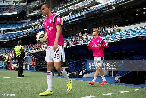 Martin Odegaard of Real Madrid CF acces the pithc with his teammate Borja Mayoral prior to start his warming up before the La Liga match between Real...