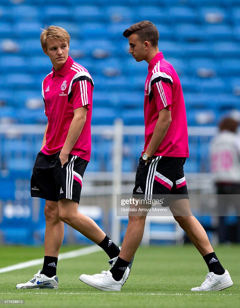 Martin Odegaard of Real Madrid CF and team-mate Borja Mayoral leave the pitch before the La Liga match between Real Madrid CF and UD Almeria at Estadio Santiago Bernabeu on April 29, 2015 in Madrid, Spain.