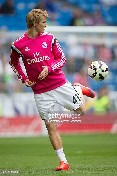 Martin Odegaard of Real Madrid CF controls the ball during his warming up before the La Liga match between Real Madrid CF and UD Almeria at Estadio...