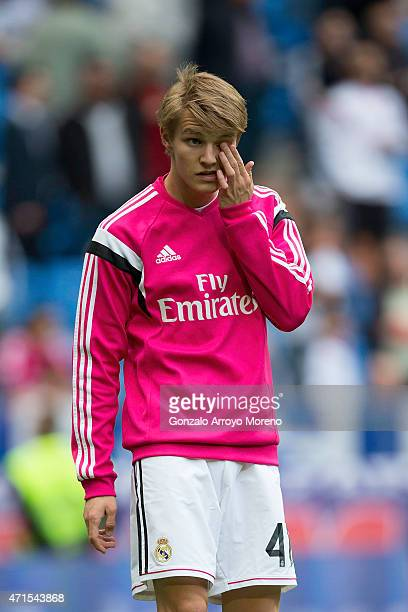 Martin Odegaard of Real Madrid CF gestures during his warming up before the La Liga match between Real Madrid CF and UD Almeria at Estadio Santiago...