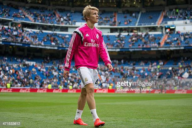 Martin Odegaard of Real Madrid CF leaves the pitch after his warming up before the La Liga match between Real Madrid CF and UD Almeria at Estadio...