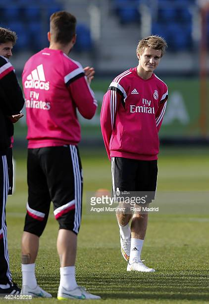 Martin Odegaard of Real Madrid looks on during a training session at Valdebebas training ground on January 29 2015 in Madrid Spain
