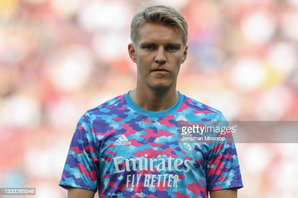 Martin Odegaard of Real Madrid looks on during the warm up prior to the Pre-season friendly match between Real Madrid and AC Milan at Worthersee...