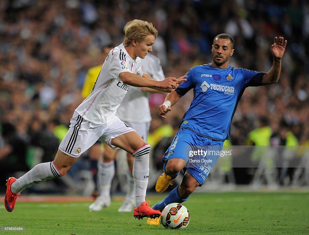 Martin Odegaard of Real Madridis tackled by Medhi Lacen of Getafe CF during the La Liga match between Real Madrid CF and Getafe CF at Estadio Santiago Bernabeu on May 23, 2015 in Madrid, Spain.