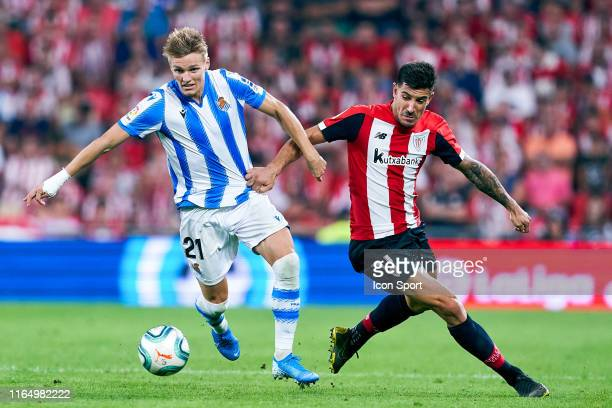 Martin Odegaard of Real Sociedad and Yuri Berchiche of Athletic Club during the Liga match between Athletic Club and Real Sociedad at San Mames...