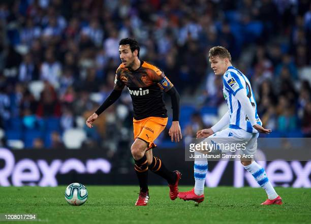 Martin Odegaard of Real Sociedad duels for the ball with Daniel Parejo of Valencia CF during the Liga match between Real Sociedad and Valencia CF at...