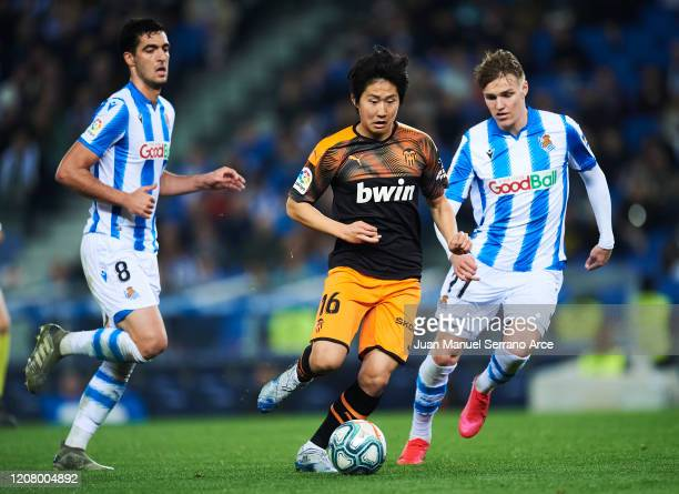 Martin Odegaard of Real Sociedad duels for the ball with Lee KangIn of Valencia CF during the Liga match between Real Sociedad and Valencia CF at...