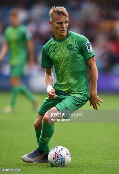 Martin Odegaard of Real Sociedad runs with the ball during the PreSeason Friendly between Millwall and Real Sociedad at The Den on July 27 2019 in...