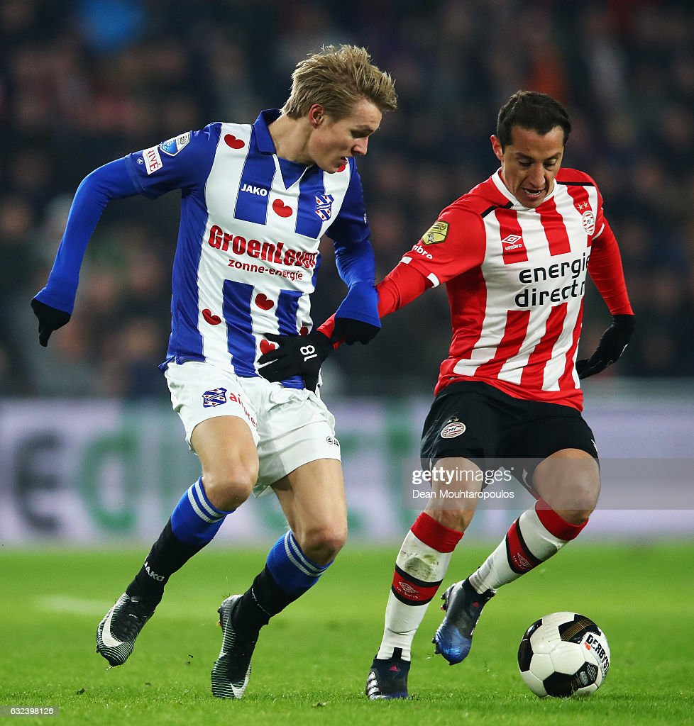 Martin Odegaard of sc Heerenveen battles for the ball with Andres Guardado of PSV during the Dutch Eredivisie match between PSV Eindhoven and SC Heerenveen held at Philips Stadion on January 22, 2017 in Eindhoven, Netherlands.