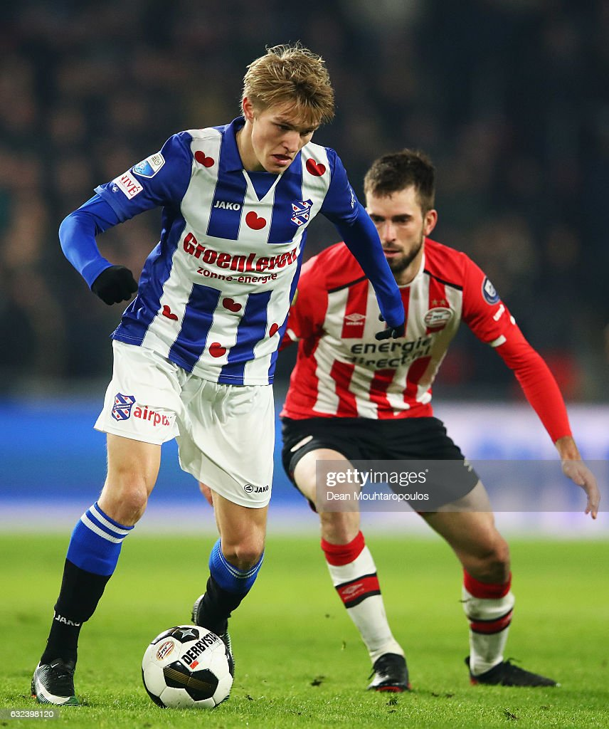 Martin Odegaard of sc Heerenveen battles for the ball with Davy Propper of PSV during the Dutch Eredivisie match between PSV Eindhoven and SC Heerenveen held at Philips Stadion on January 22, 2017 in Eindhoven, Netherlands.