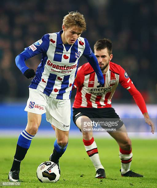 Martin Odegaard of sc Heerenveen battles for the ball with Davy Propper of PSV during the Dutch Eredivisie match between PSV Eindhoven and SC...