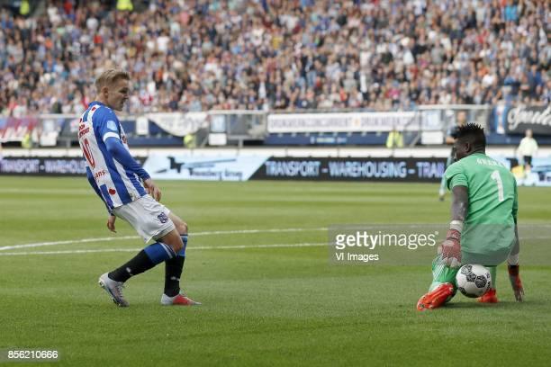 Martin Odegaard of sc Heerenveen goalkeeper Andre Onana of Ajax during the Dutch Eredivisie match between sc Heerenveen and Ajax Amsterdam at Abe...