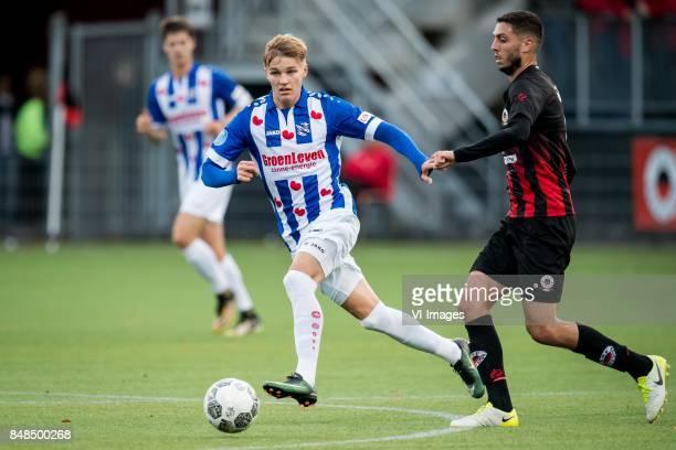 Martin Odegaard of sc Heerenveen Hicham Faik of Excelsior during the Dutch Eredivisie match between sbv Excelsior Rotterdam and sc Heerenveen at Van...
