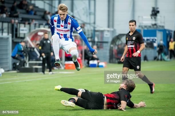 Martin Odegaard of sc Heerenveen Milan Massop of Excelsior during the Dutch Eredivisie match between sbv Excelsior Rotterdam and sc Heerenveen at Van...