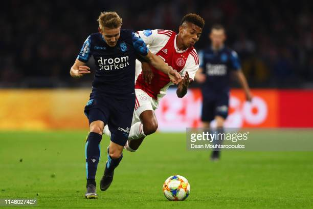 Martin Odegaard of Vitesse battles for the ball with David Neres of Ajax during the Eredivisie match between Ajax and Vitesse at Johan Cruyff Arena...