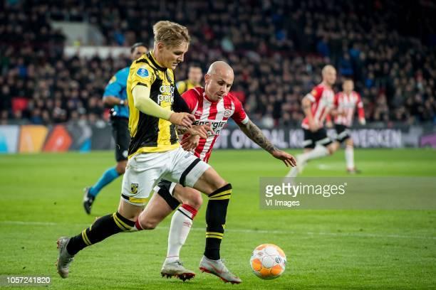 Martin Odegaard of Vitesse Jos çngel Tasende Angelino of PSV during the Dutch Eredivisie match between PSV Eindhoven and Vitesse Arnhem at the...