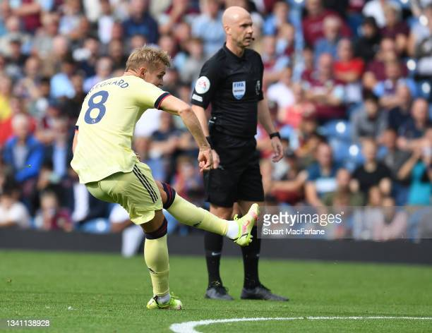 Martin Odegaard score the Arsenal goal during the Premier League match between Burnley and Arsenal at Turf Moor on September 18, 2021 in Burnley,...