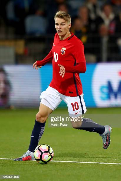 Martin Oedegaard of Norway runs with the ball during the UEFA Under21 Euro 2019 Qualifier match between U21 of Norway and U21 of Germany at...