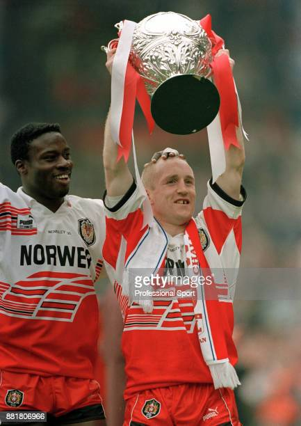 Martin Offiah and Shaun Edwards of Wigan with the trophy after their 3010 victory over Leeds in the Silk Cut Rugby League Challenge Cup Final at...