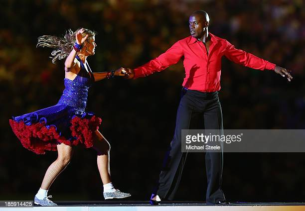 Martin Offiah ex rugby player performs during the opening ceremony ahead of the Rugby League World Cup Group A match between Australia and England at...