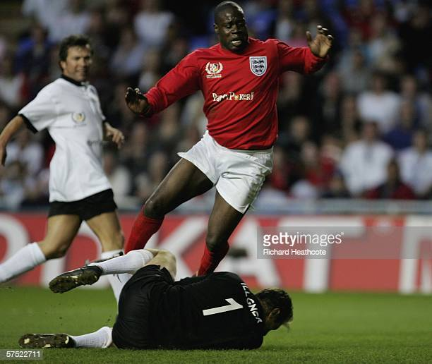Martin Offiah of England is brought down by German goalkeeper Bodo Illgner during the Legends match between England and Germany at The Madejski...