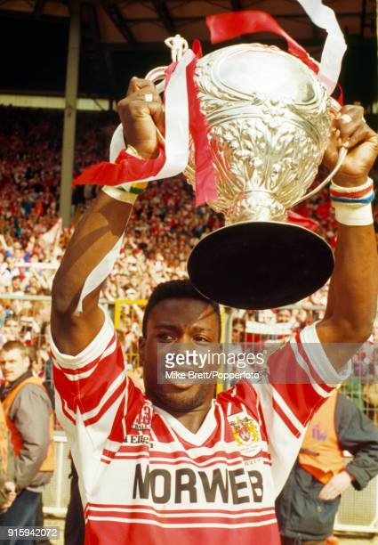 Martin Offiah of Wigan rugby league holds the trophy aloft after their 2812 victory over Castleford in the Rugby League Challenge Cup Final at...