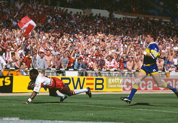Martin Offiah of Wigan scores one of his two tries against Leeds in the Silk Cut Challenge Cup final at Wembley Stadium London 30th April 1994 Wigan...