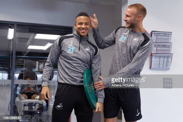 Martin Olsson and Mike van der Hoorn share a joke in the gym during the Swansea City Training at the Fairwood Training Ground on November 22 2018 in...