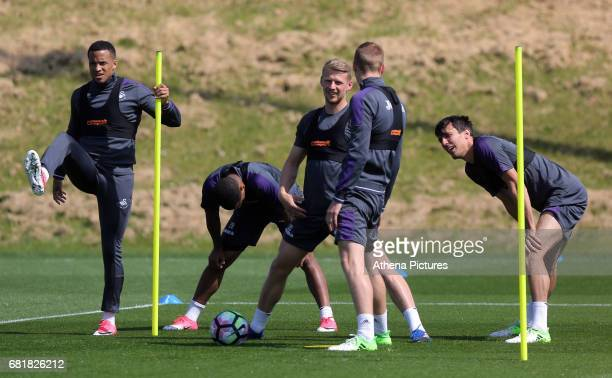 Martin Olsson Luciano Narsingh Stephen Kingsley Oliver McBurnie and Jack Cork warm up during the Swansea City Training at The Fairwood Training...