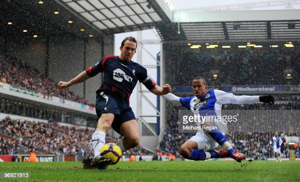 Martin Olsson of Blackburn challenges Kevin Davies of Bolton during the Barclays Premier League match between Blackburn Rovers and Bolton Wanderers...