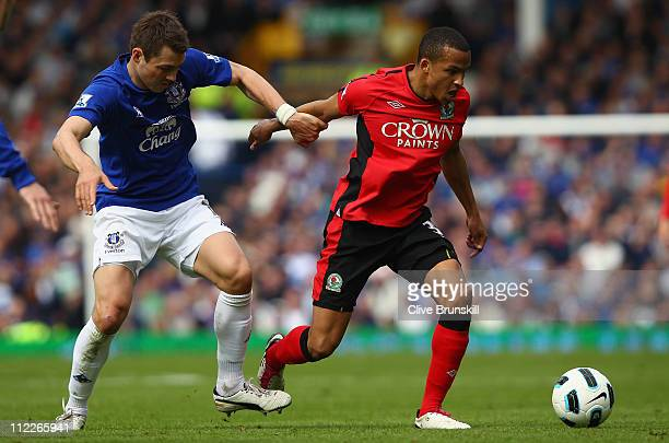 Martin Olsson of Blackburn Rovers attempts to move away from Diniyar Bilyaletdinov of Everton during the Barclays Premier League match between...