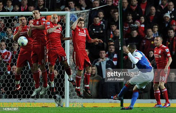 2ad81c0c1ccbb Martin Olsson of Blackburn Rovers takes a free kick as Jordan Henderson  Andy Carroll Jonjo Shelvey