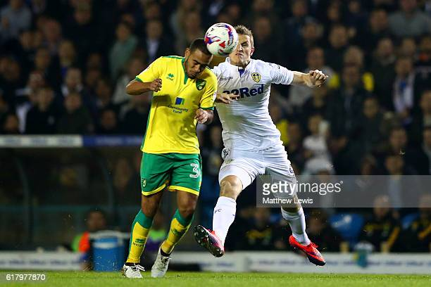 Martin Olsson of Norwich City and Chris Wood of Leeds United battle for possession during the EFL Cup fourth round match between Leeds United and...