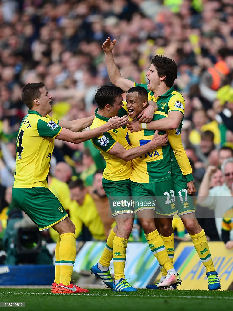 Martin Olsson (2nd R) of Norwich City celebrates scoring his team's third goal with his team mates during the Barclays Premier League match between Norwich City and Newcastle United at Carrow Road on April 2, 2016 in Norwich, England.