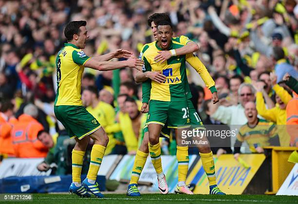 Martin Olsson of Norwich City celebrates scoring his team's third goal with his team mates during the Barclays Premier League match between Norwich...