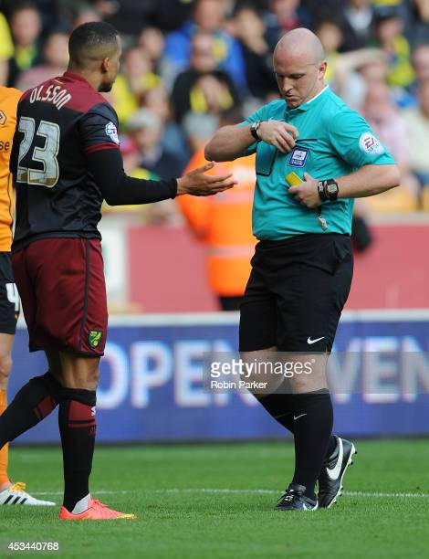 Martin Olsson of Norwich City is seen before being shown the red card by referee Simon Hooper during the Sky Bet Championship match between...