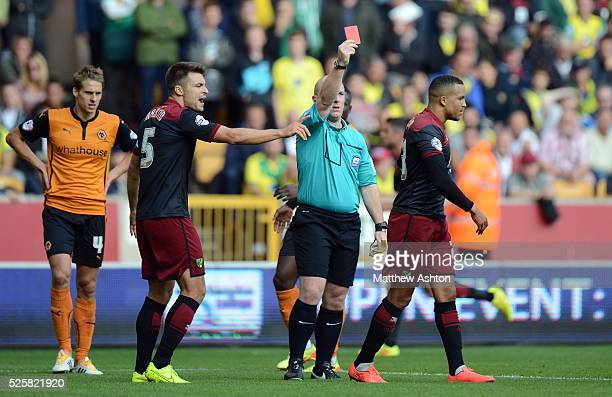 Martin Olsson of Norwich City is shown a red card by referee Simon Hooper after benign sent off for a foul on Rajiv van La Parra of Wolverhampton...