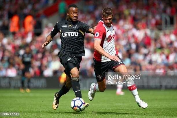 Martin Olsson of Swansea City and Jack Stephens of Southampton battle for possession during the Premier League match between Southampton and Swansea...