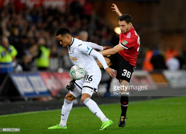 Martin Olsson of Swansea City and Matteo Darmian of Manchester United in action during the Carabao Cup Fourth Round match between Swansea City and...