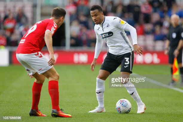Martin Olsson of Swansea City and Stewart Downing of Middlesbrough in action during the Sky Bet Championship match between Middlesbrough and Swansea...