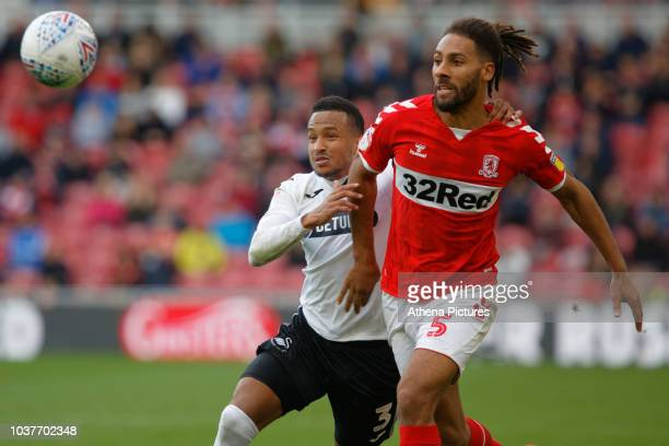 Martin Olsson of Swansea City challenges Ryan Shotton of Middlesbrough during the Sky Bet Championship match between Middlesbrough and Swansea City...
