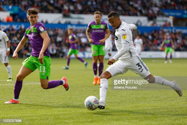 Martin Olsson of Swansea City crosses the ball past Callum O'Dowda of Bristol City during the Sky Bet Championship match between Swansea City and...