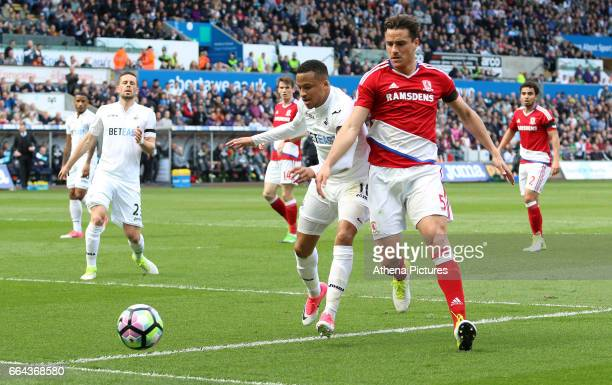 Martin Olsson of Swansea City is challenged by Bernardo Espinosa of Middlesbrough during the Premier League match between Swansea City and...