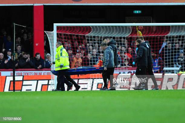 Martin Olsson of Swansea City is stretchered off during the Sky Bet Championship match between Brentford and Swansea City at Griffin Park on December...