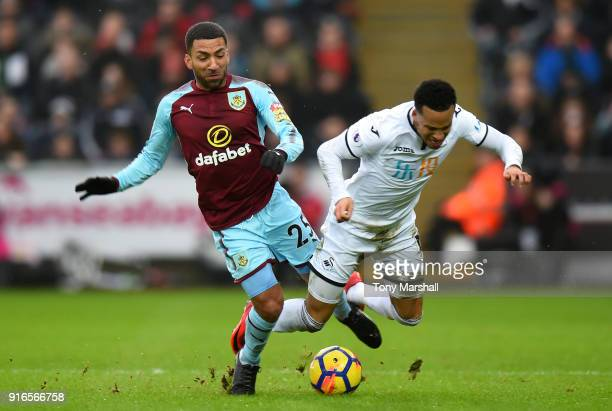 Martin Olsson of Swansea City is tackled by Aaron Lennon of Burnley during the Premier League match between Swansea City and Burnley at Liberty...