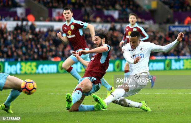 Martin Olsson of Swansea City scores his sides second goal as George Boyd of Burnley attempts to block the shot during the Premier League match...