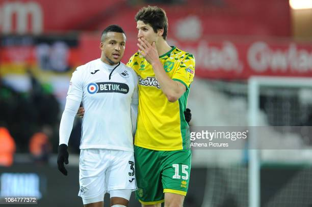 Martin Olsson of Swansea City speaks with Timm Klose of Norwich City during the Sky Bet Championship match between Swansea City and Norwich City at...
