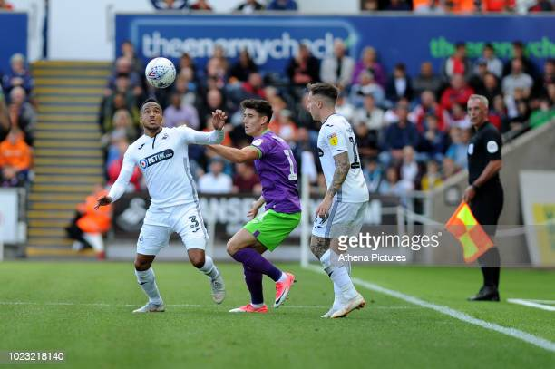 Martin Olsson of Swansea City vies for possession with Callum O'Dowda of Bristol City during the Sky Bet Championship match between Swansea City and...