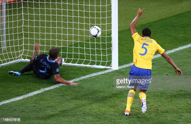 Martin Olsson of Sweden celebrates after Glen Johnson of England fails to stop Olof Mellberg of Sweden's goal during the UEFA EURO 2012 group D match...