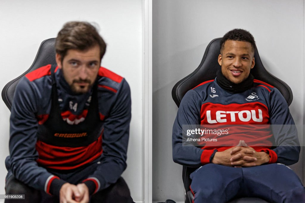 Martin Olsson (R) sits in the changing room during the Swansea City Training at The Liberty Stadium on April 26, 2018 in Swansea, Wales.
